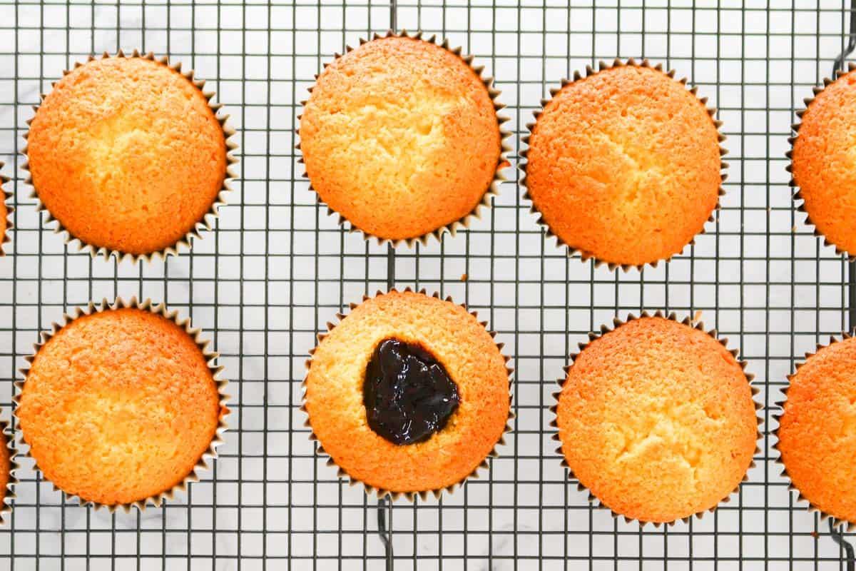 Jam inside a vanilla cupcake.