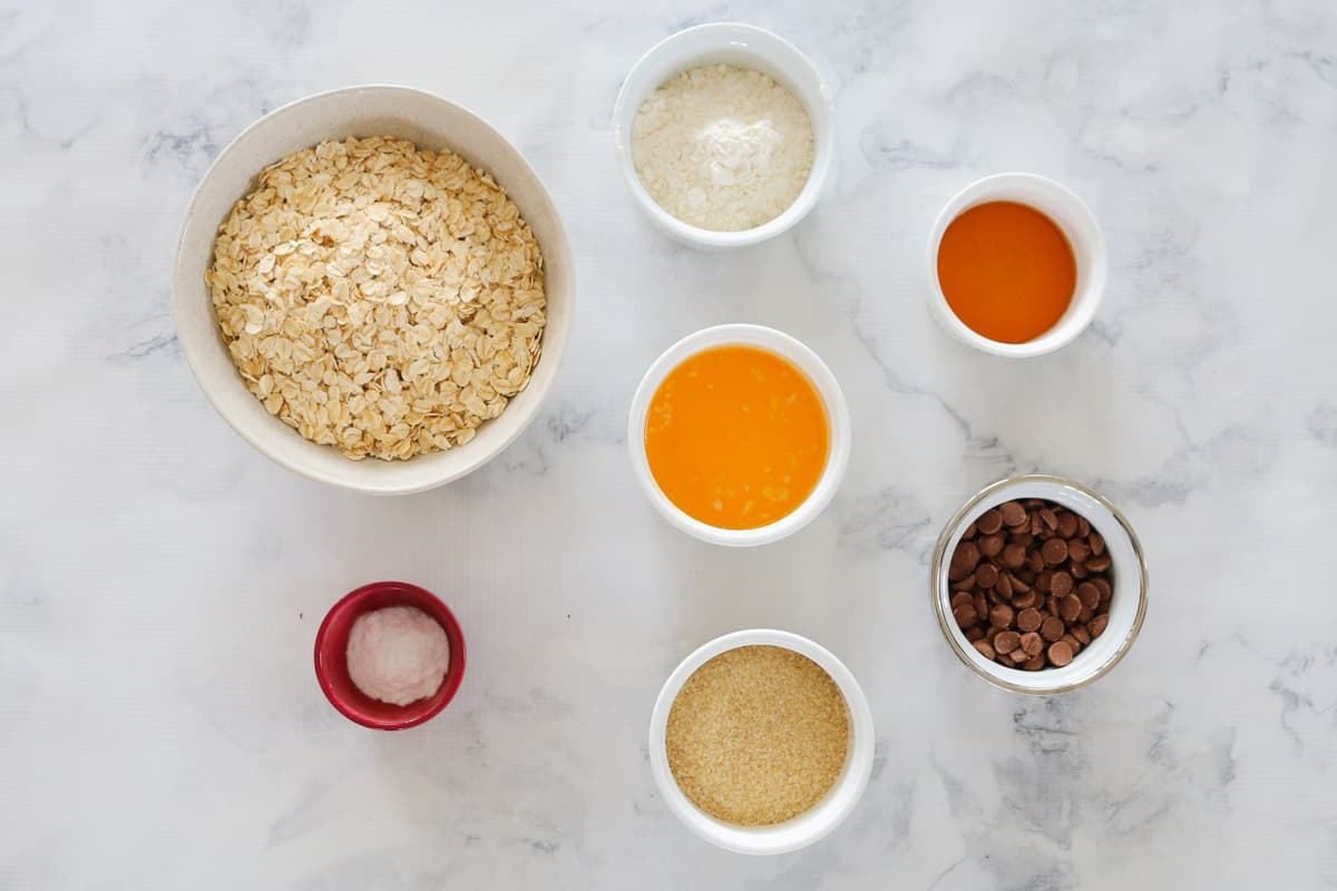 All the ingredients for oat biscuits with chocolate melts.