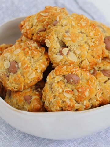 A bowl of chocolate chip oat biscuits.