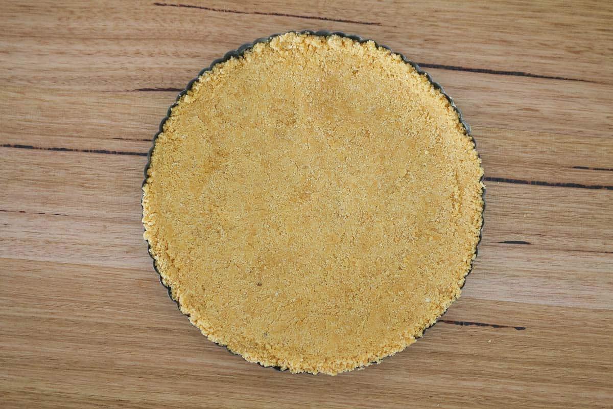 Cookie crumbs in a springform tart tin.