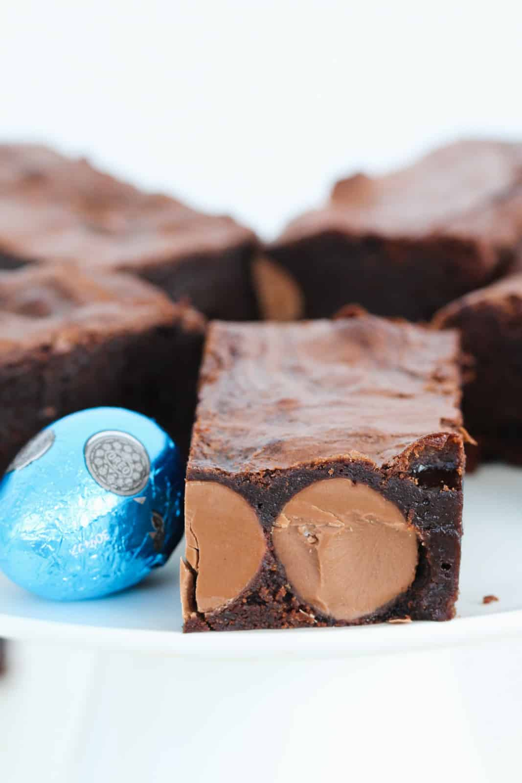 Squares of moist brownie filled with round mini solid chocolate Easter eggs.