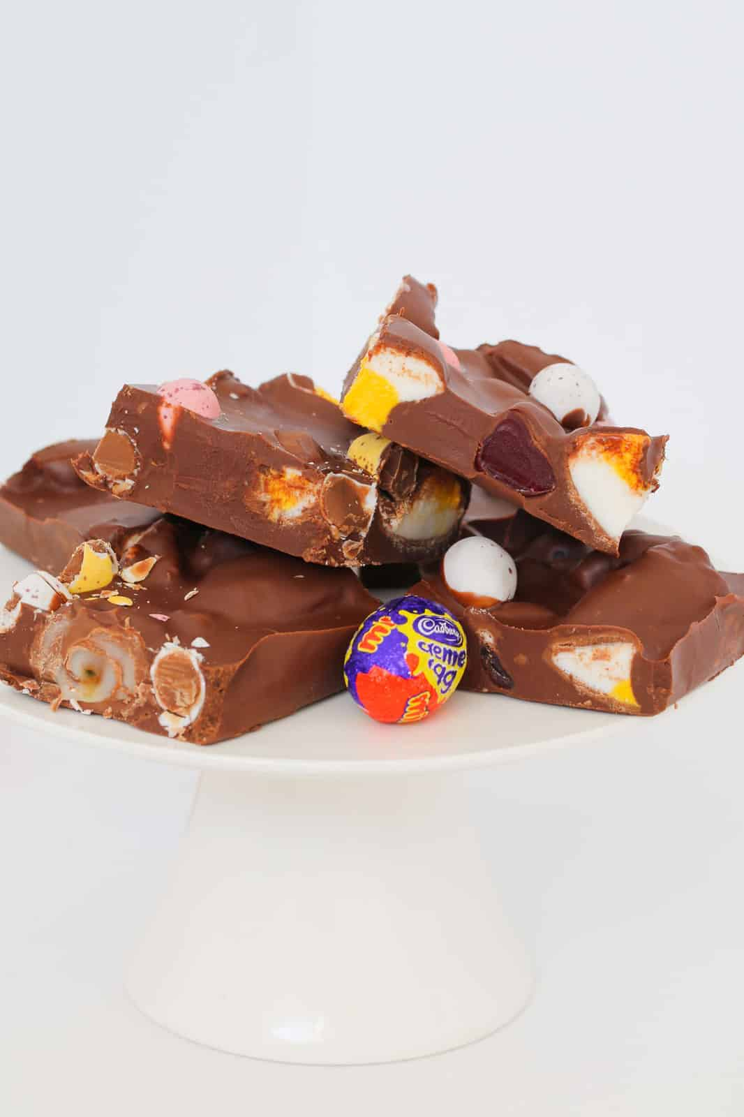 Pieces of Easter rocky road on a white plate.