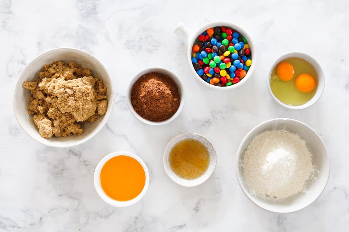 Ingredients for brownie slice in individual bowls