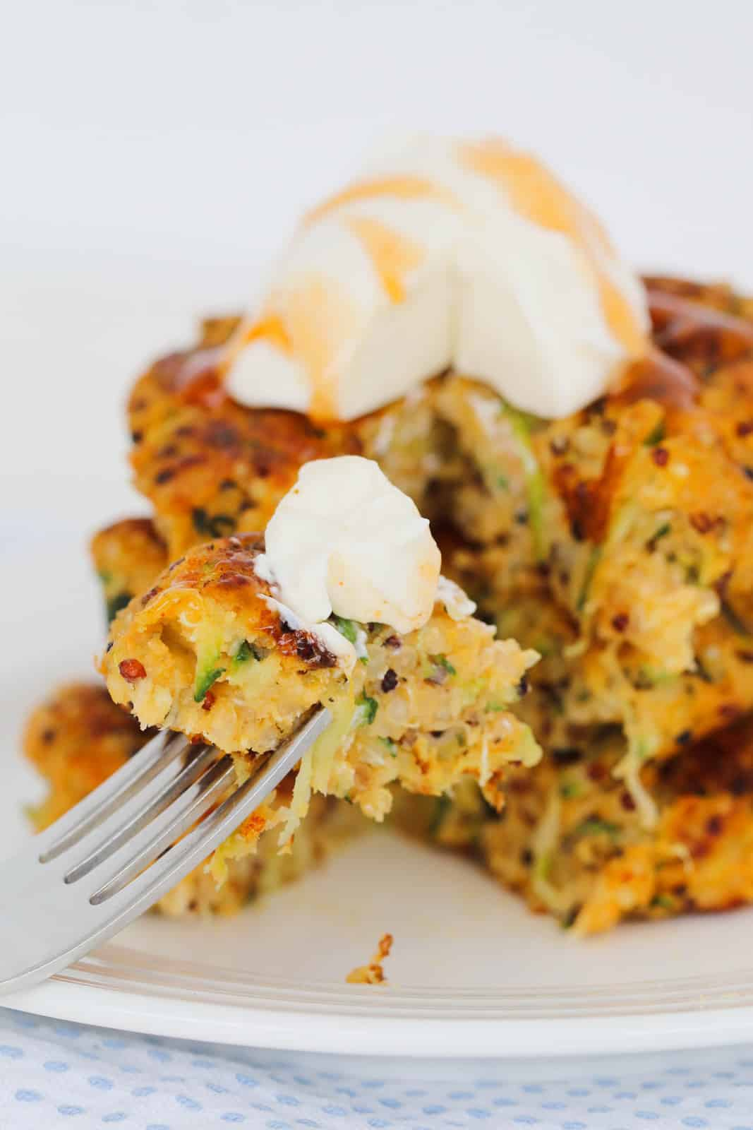 Quinoa sweet potato fritters on white plate with fork