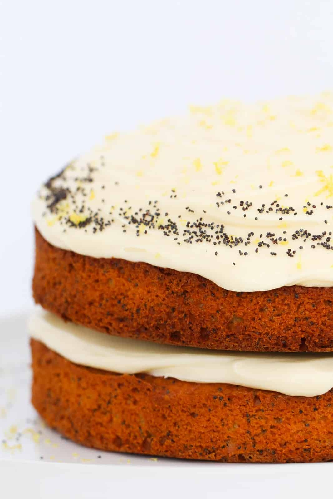 A two layer lemon cake with poppy seeds, and lemon cream cheese frosting.