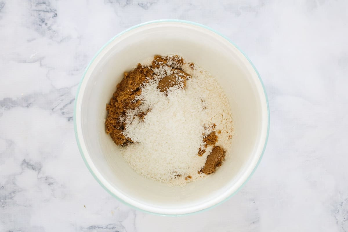 A white bowl with dry ingredients inside
