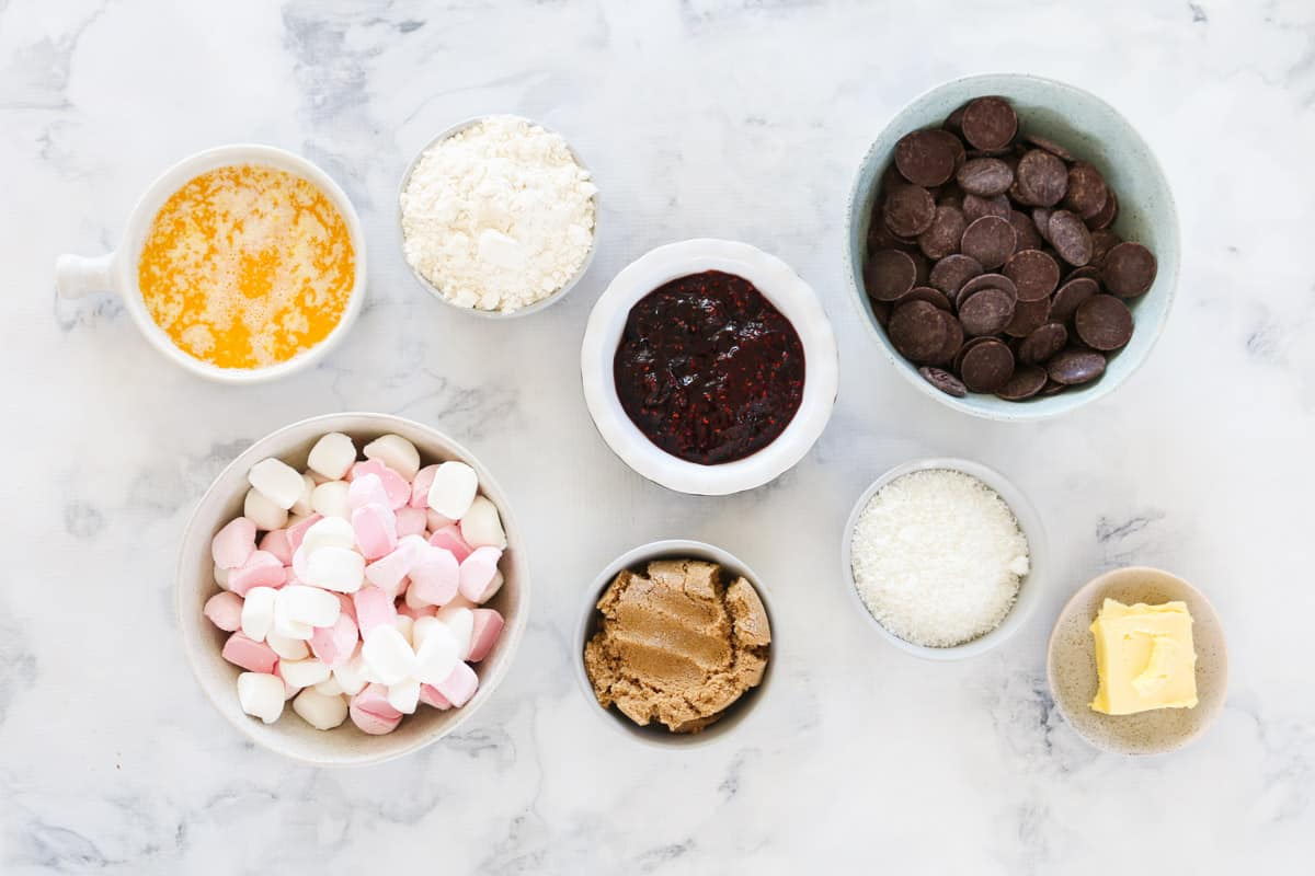 All ingredients in individual bowls on a marble bench