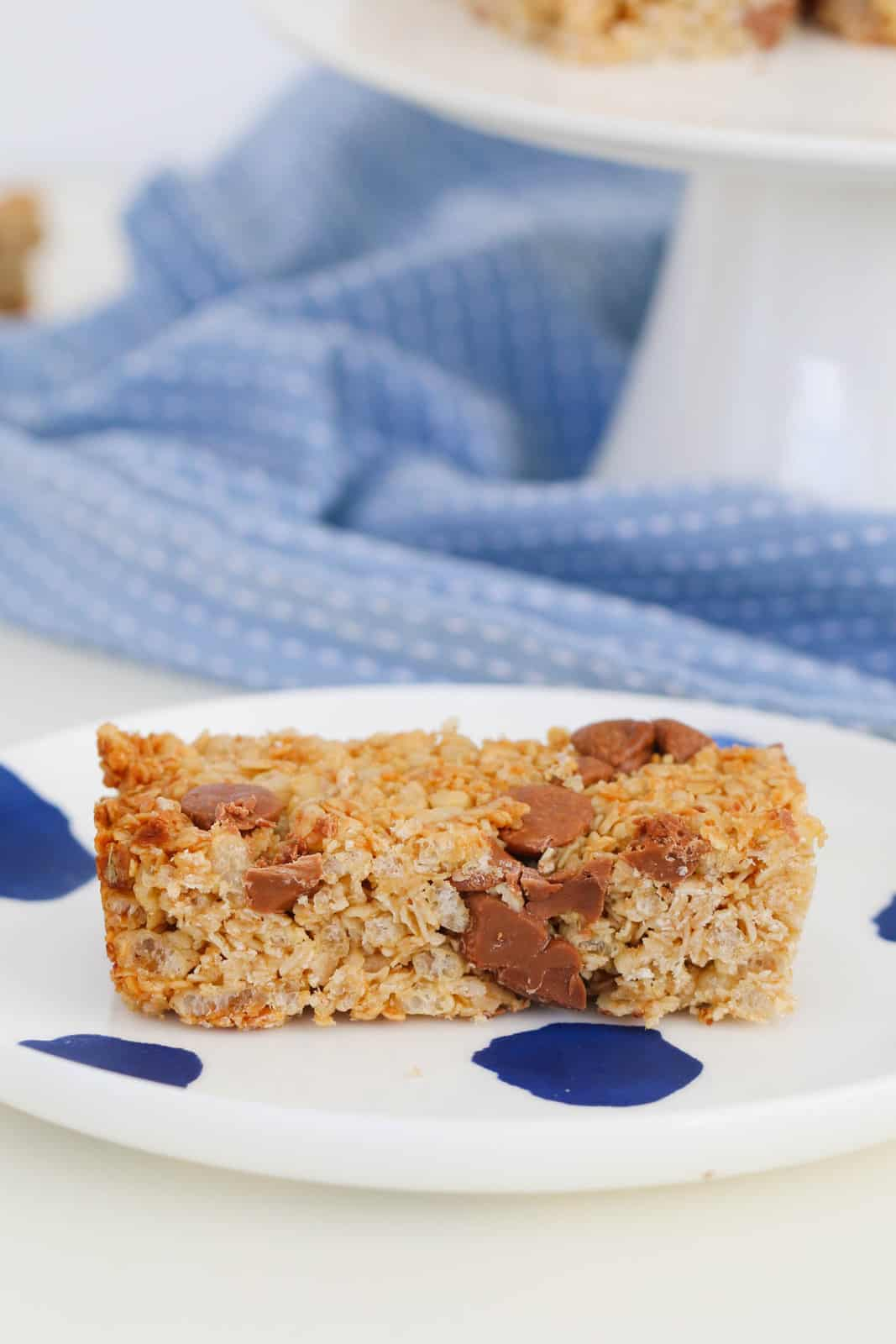 A chocolate chip granola bar on a white and blue plate