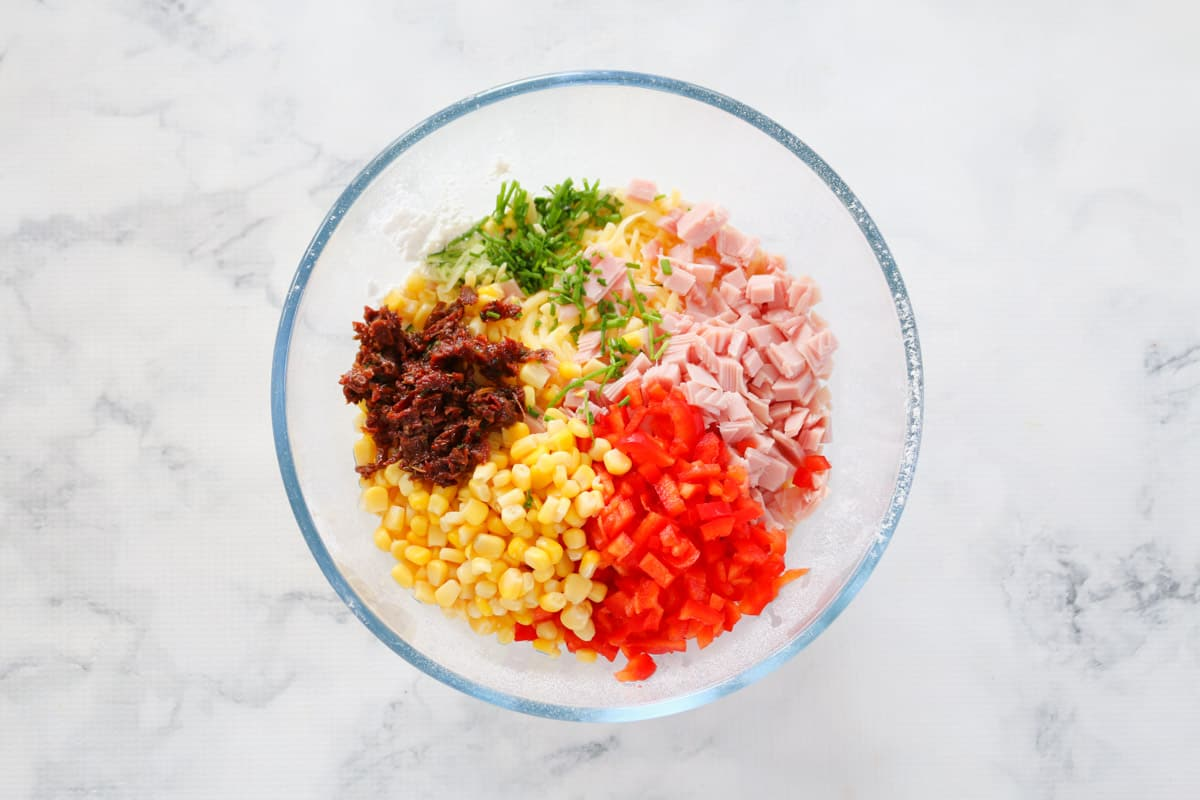 Finely chopped vegetables and ham in a bowl