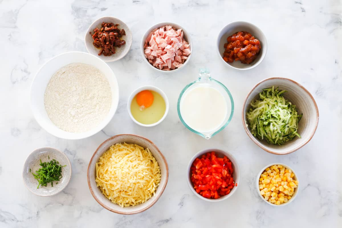 The ingredients for vegetable savoury muffins in individual bowls