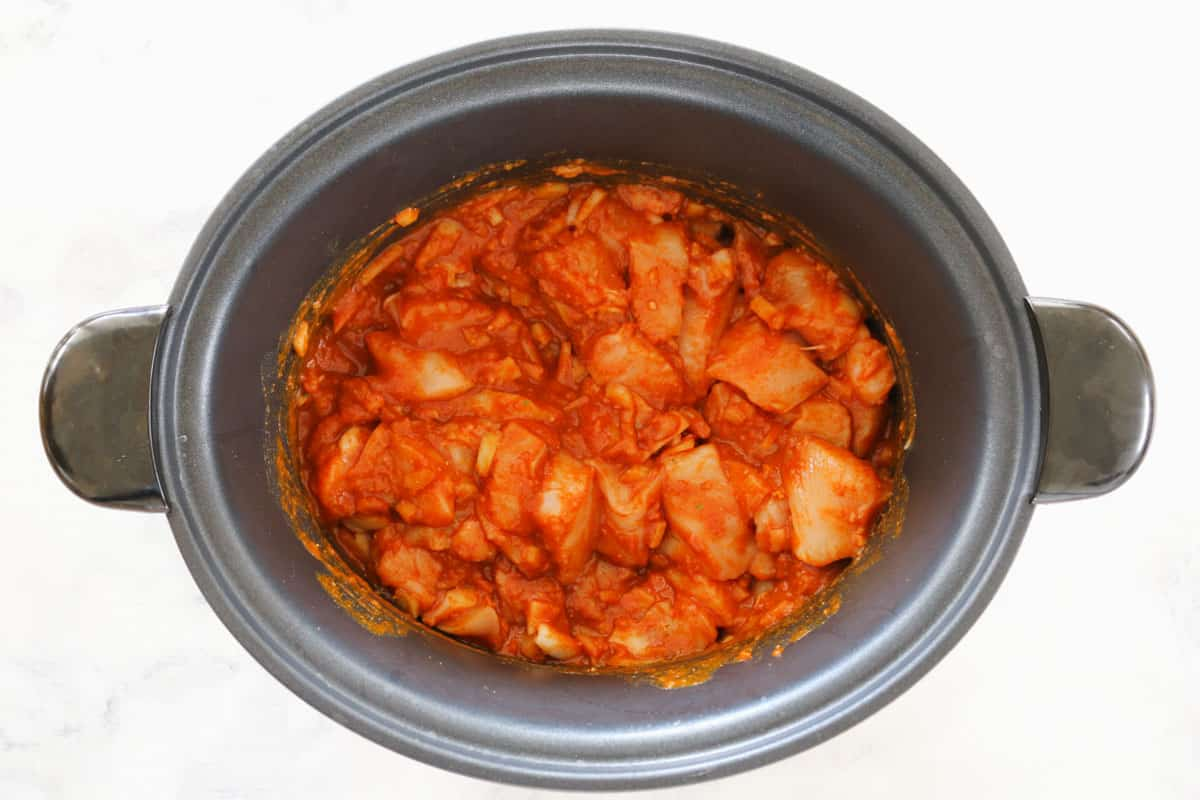 Butter chicken mixture in a slow cooker.