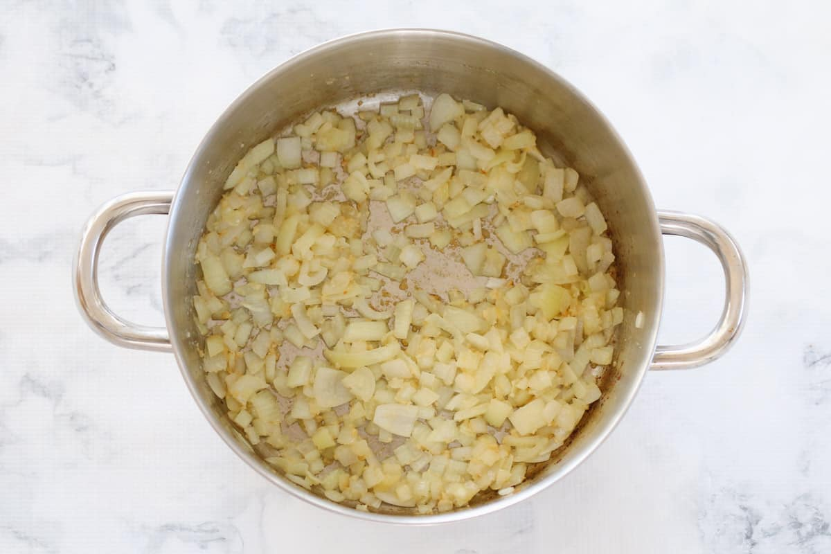 Onion and garlic sauteing in a pot