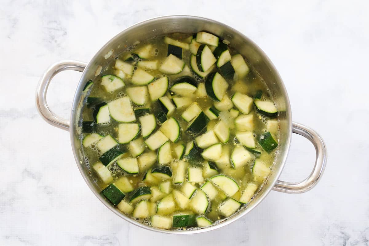 Chunks of zucchini simmering in a pot