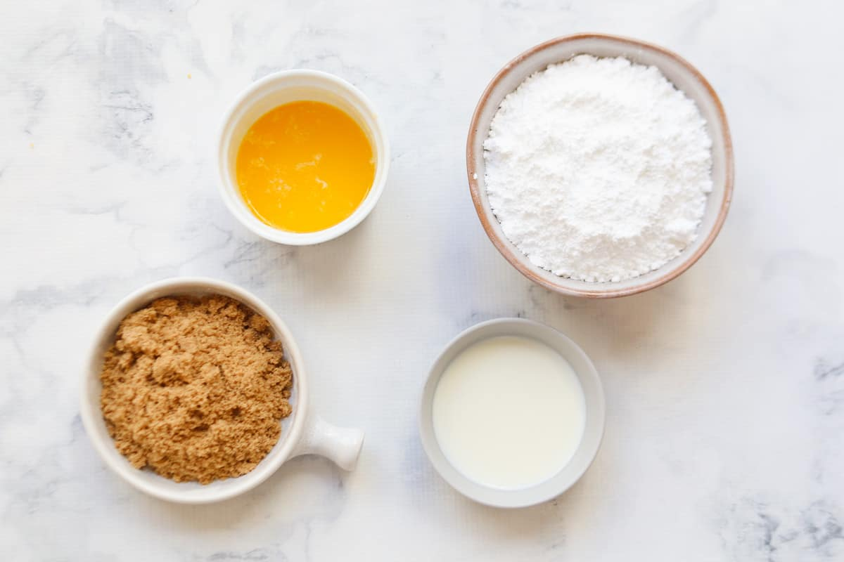 Ingredients for caramel frosting in a glass bowl