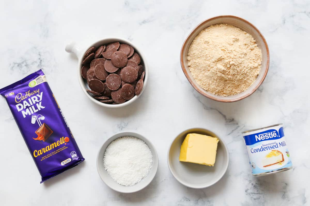 All the ingredients in separate bowls for caramello slice
