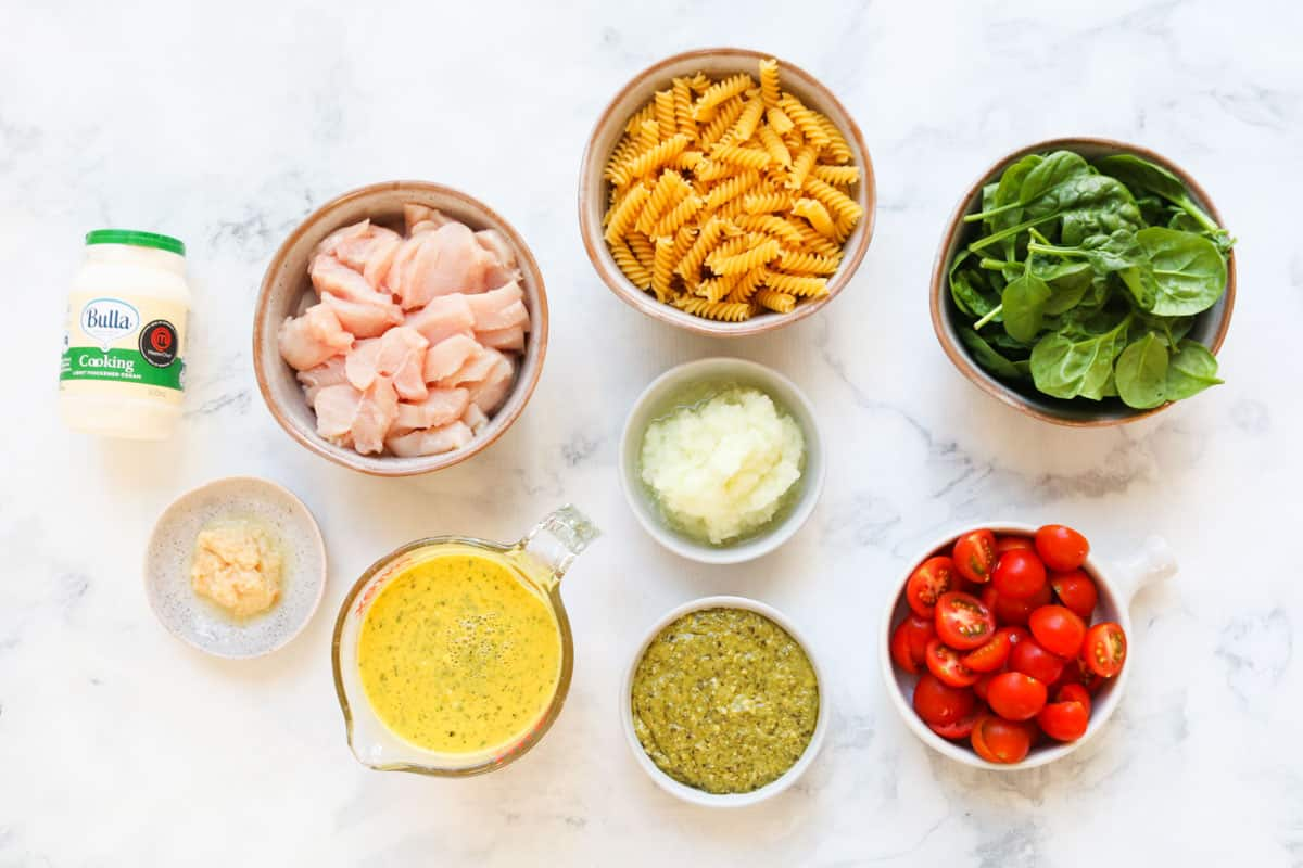 The ingredients for a creamy pesto chicken pasta.