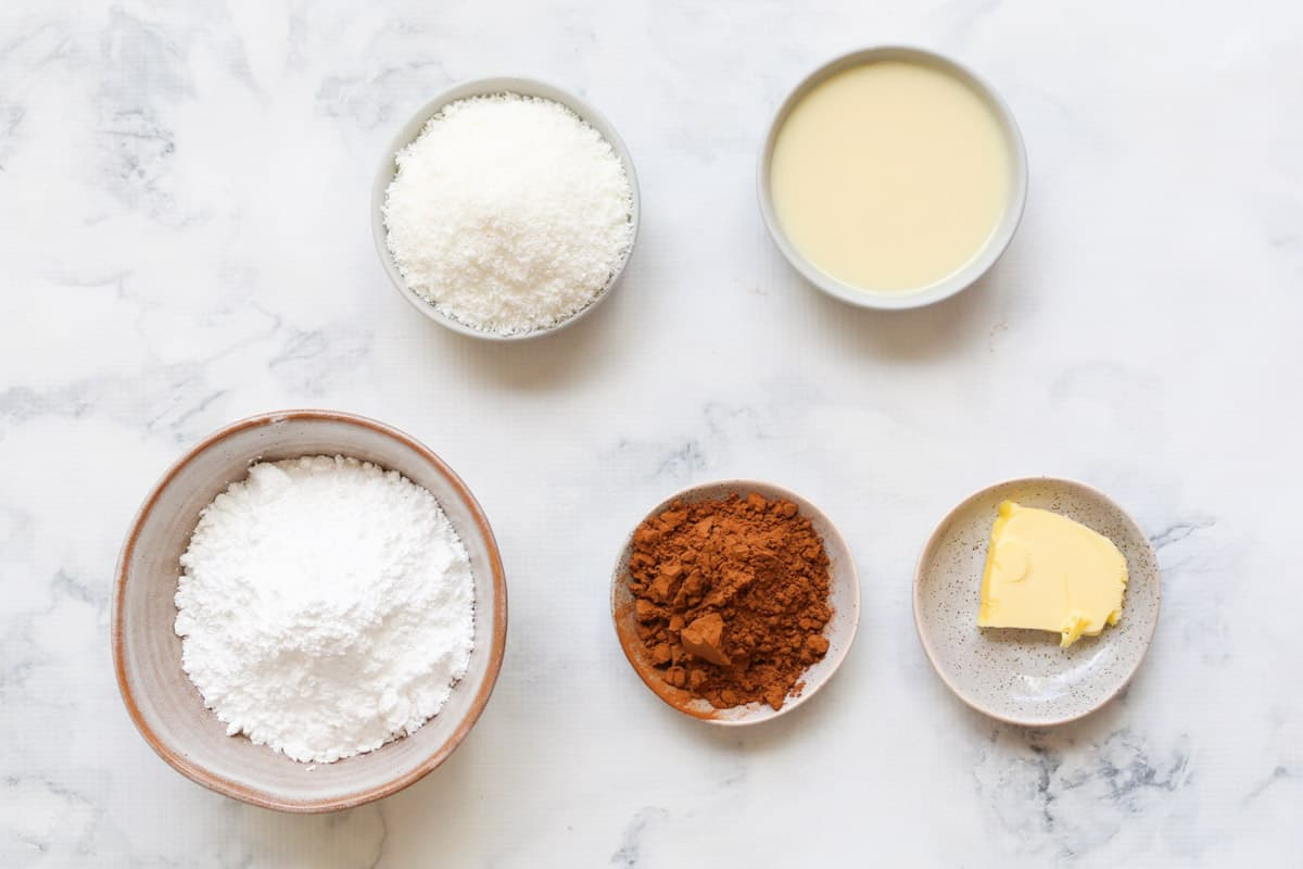 Ingredients for chocolate coconut topping in individual bowls