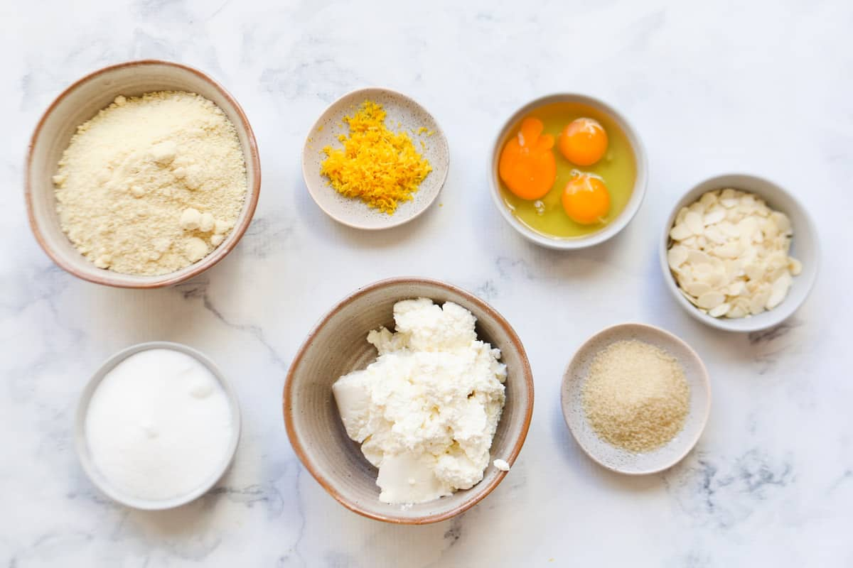 All the ingredients, in separate bowls, for gluten free lemon cake