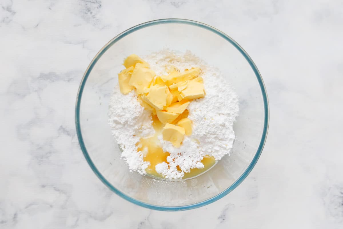 Icing ingredients in a glass bowl.