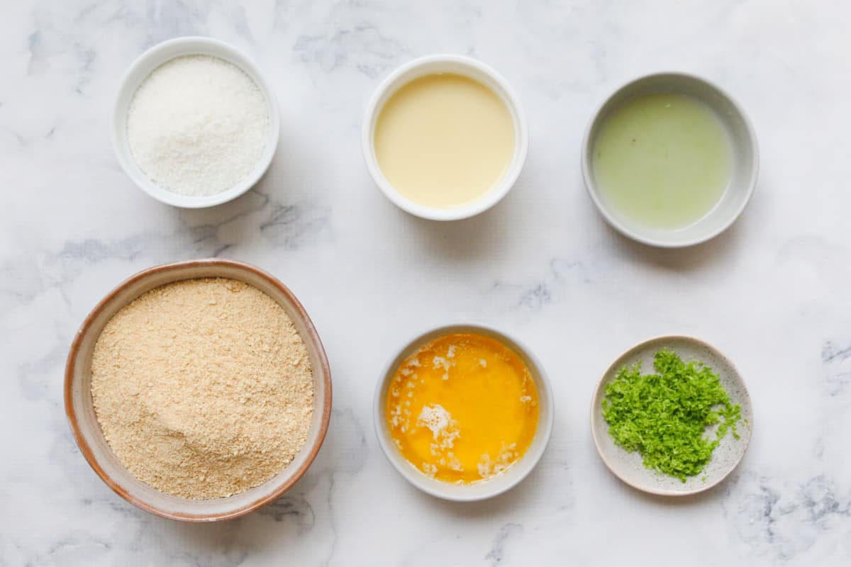 The individual ingredients for a slice in separate bowls on a benchtop.