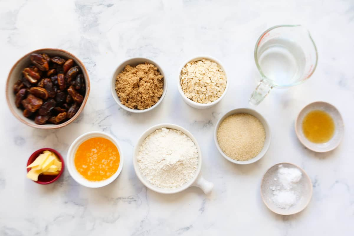 All the ingredients for date squares in individual bowls