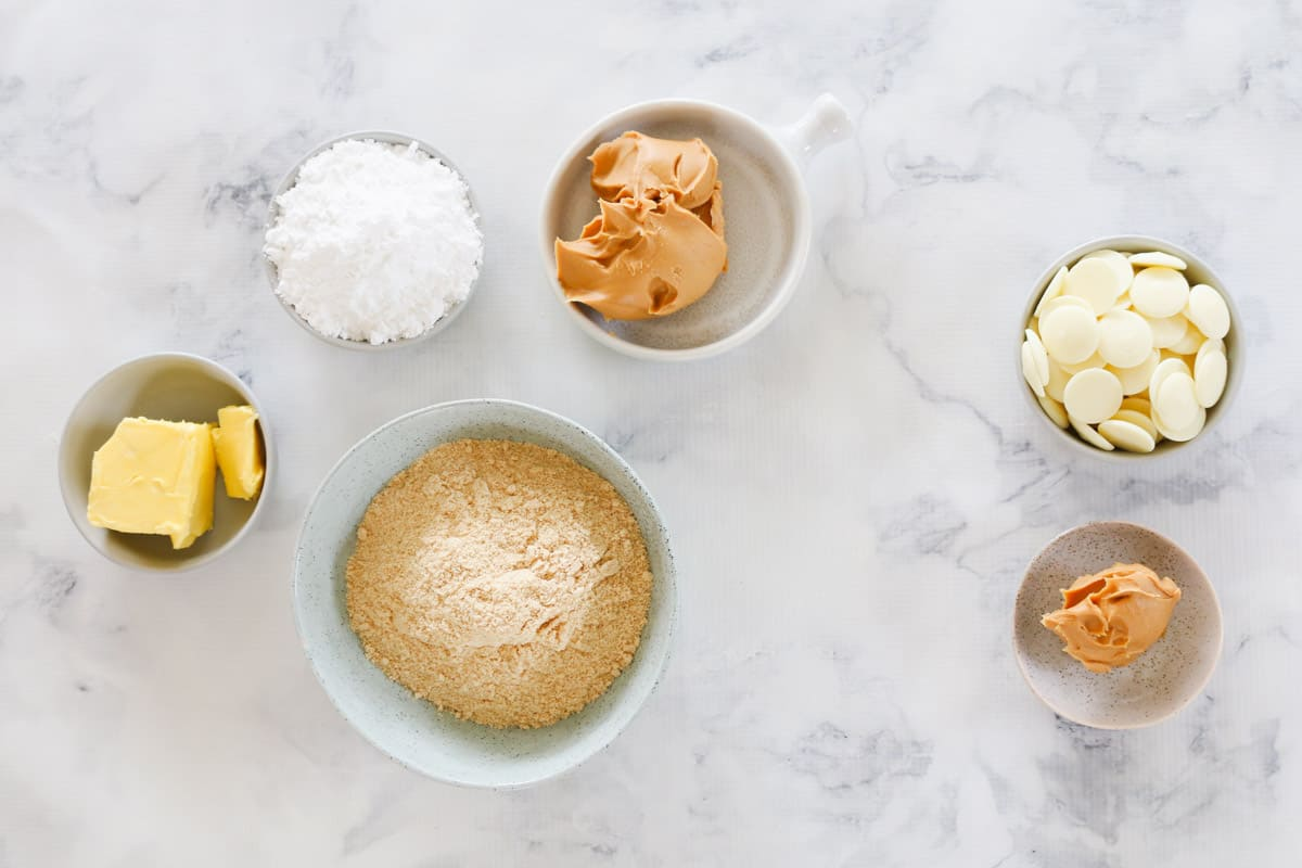 The ingredients for peanut butter slice in individual bowls.