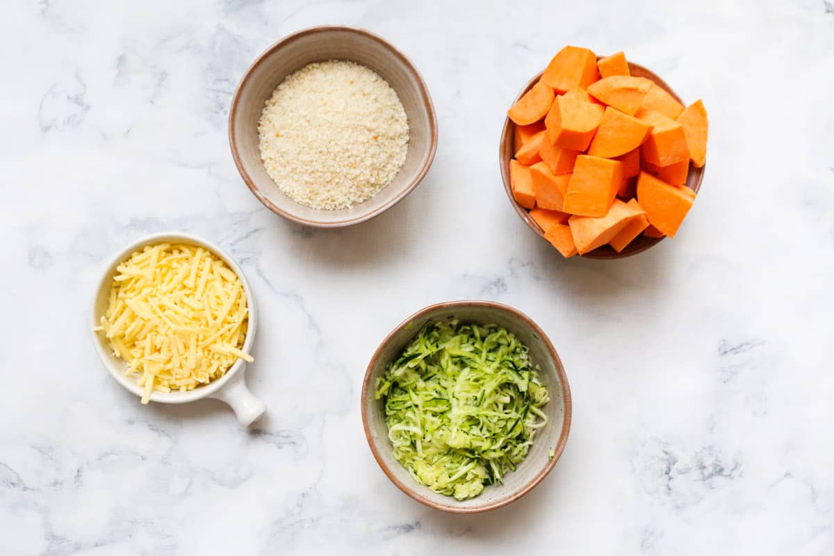 Individual ingredients for veggie nuggets in small bowls.