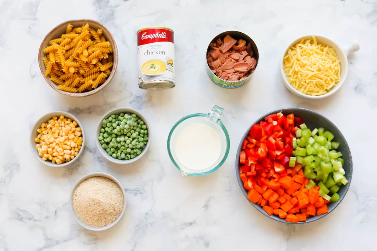 Ingredients for a tuna pasta bake laid out on a counter