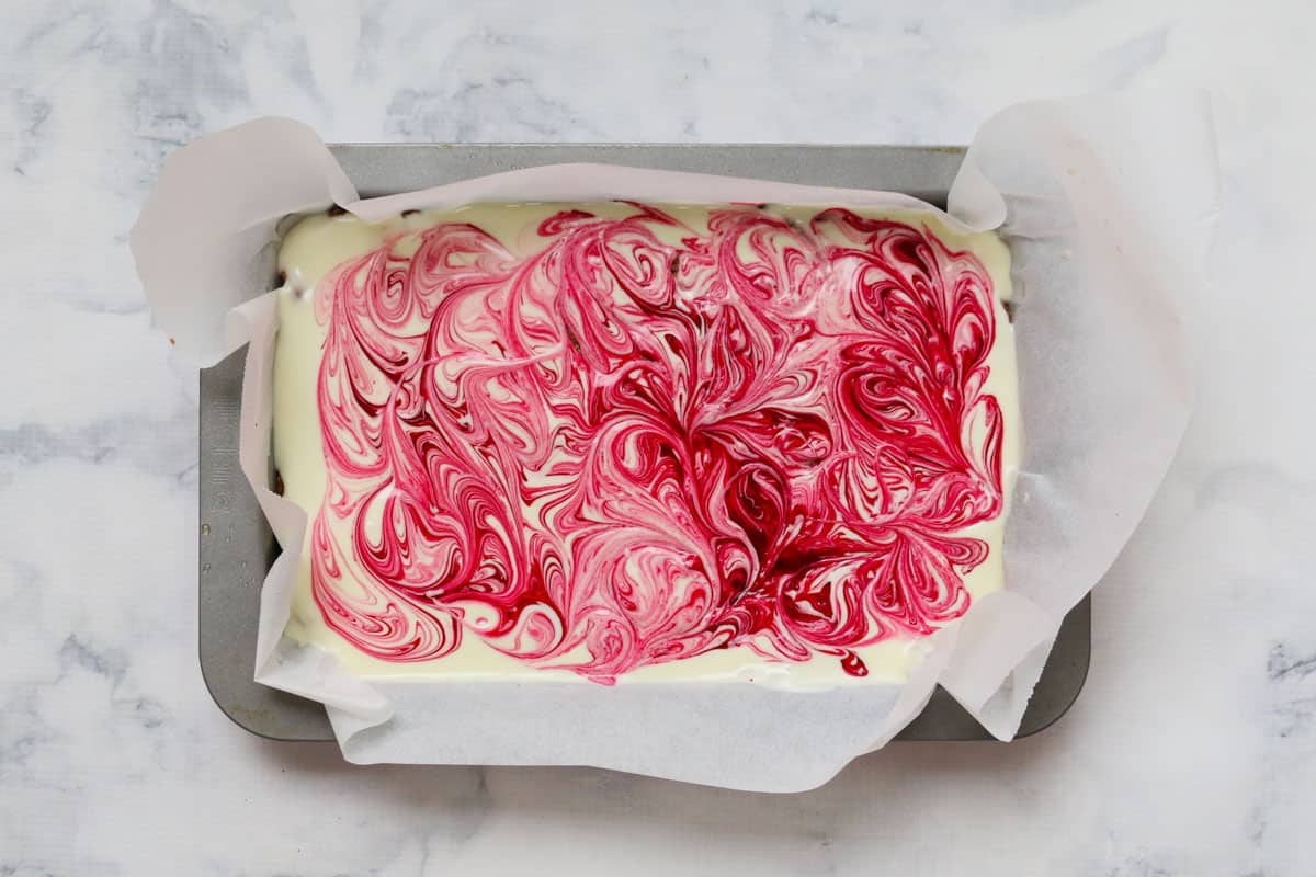 Top view of slice with white chocolate and pink swirls