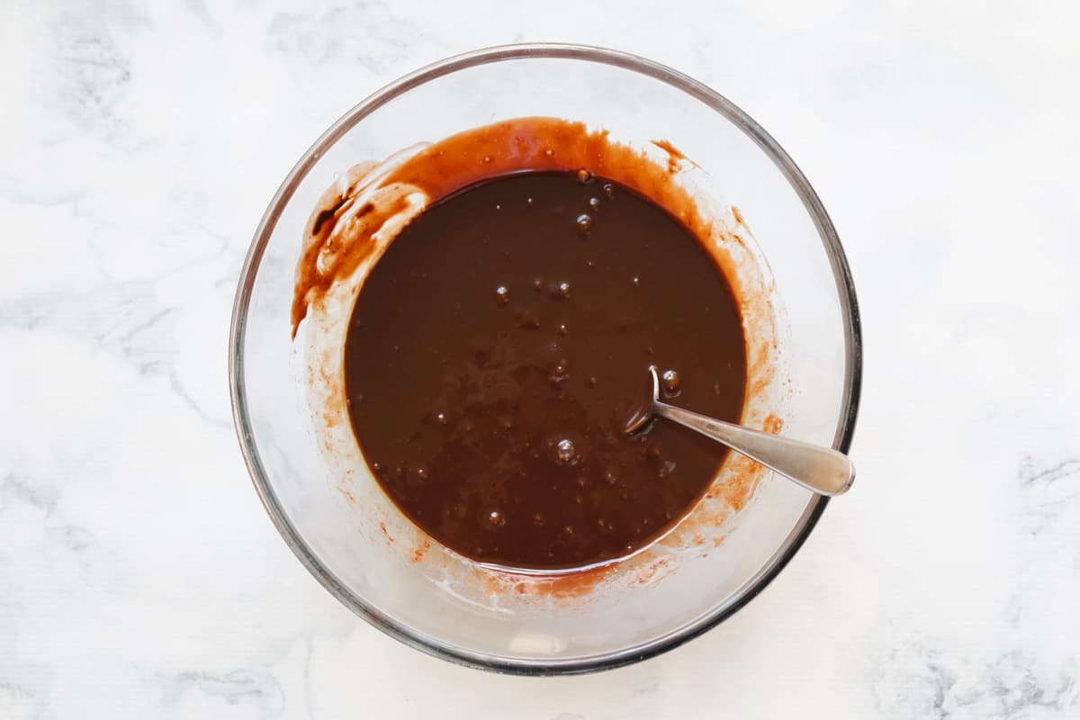 Melted chocolate, butter and condensed milk in a bowl.