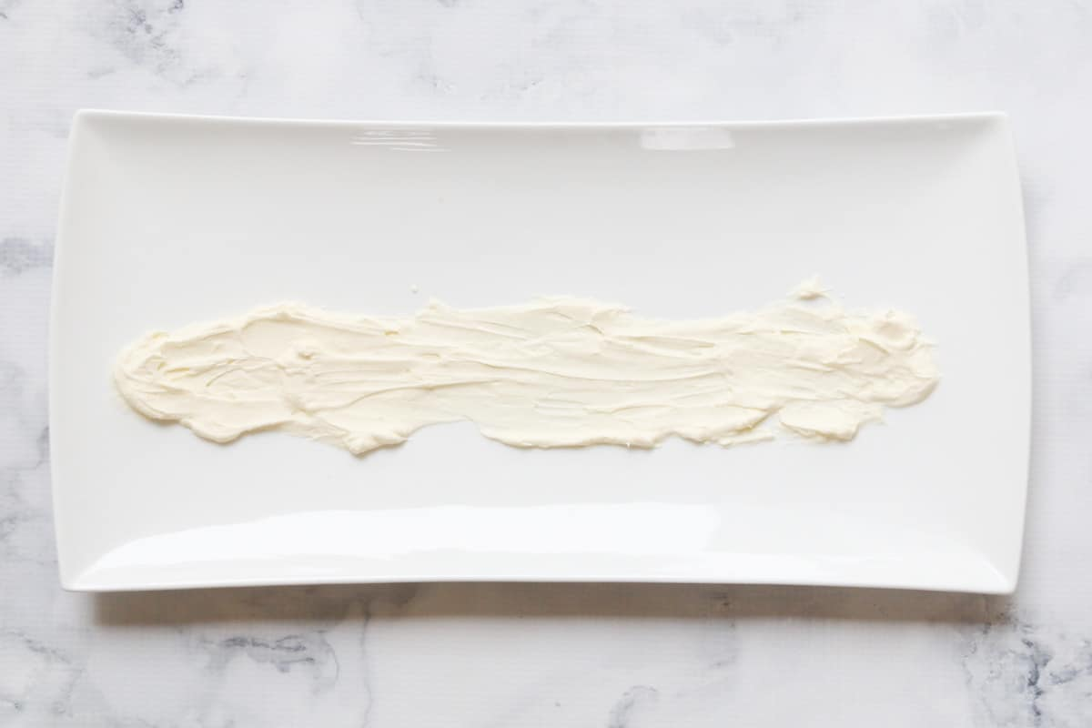 A line of whipped cream down the middle of a long serving dish.
