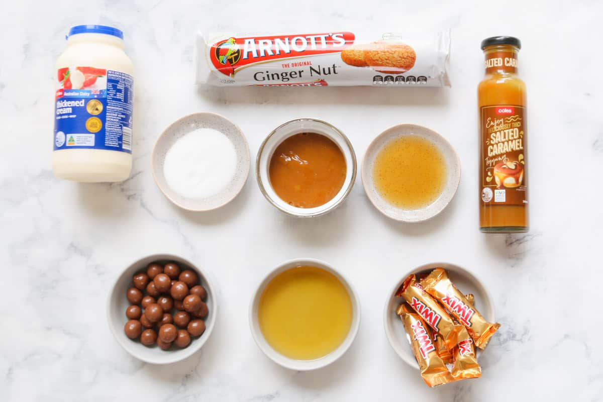 The ingredients for a gingernut log on a marble bench.