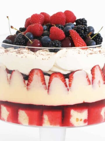 A layered strawberry trifle in a glass dish.